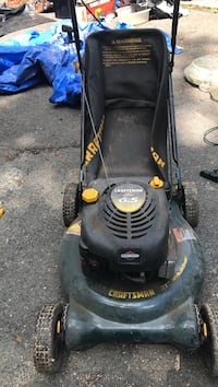 Black and yellow poulan pro push mower 20 km