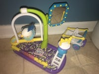 blue, yellow, and white Little Live pet toy