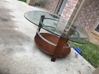 round brown wooden base glass top table