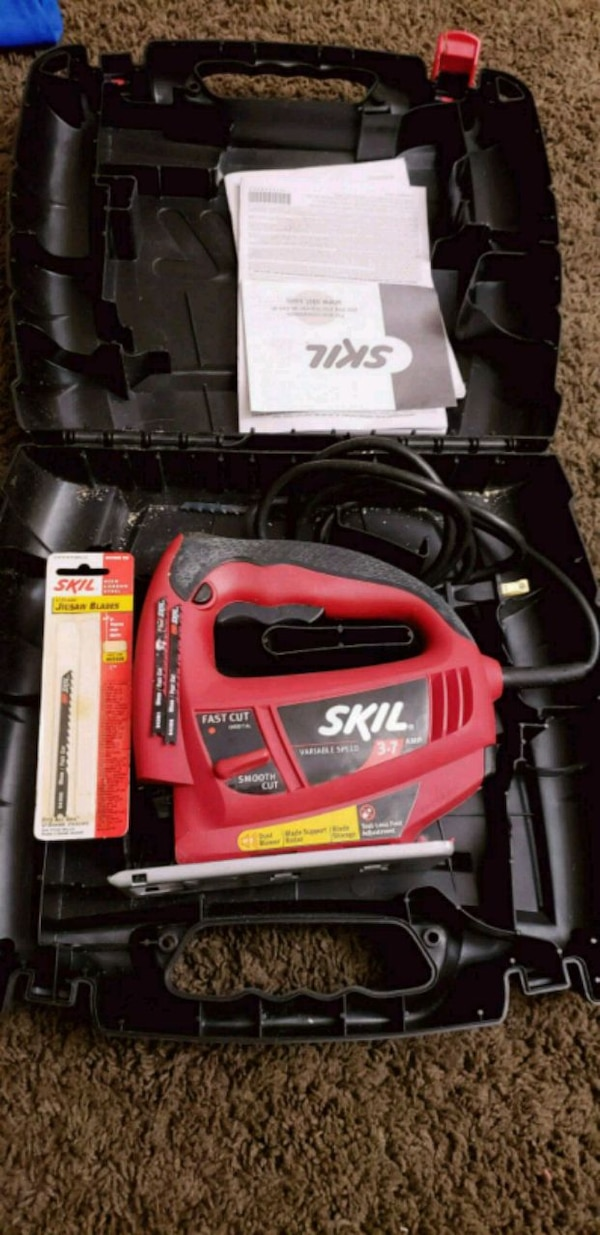 red and black Skil corded power tool in case