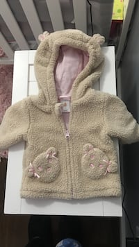 baby's brown and pink zip-up jacket