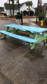 green and white wooden picnic table 374 mi