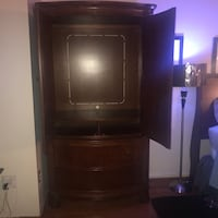 brown wooden TV hutch with CRT television 59 km