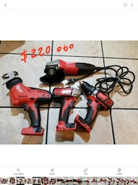 red and black Milwaukee power tool