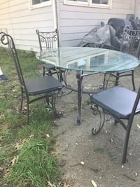 round black metal framed glass top patio table set Cuyahoga Falls