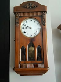 brown pendulum clock Calgary, T2X 0J9