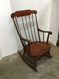 brown wooden windsor rocking chair null