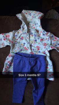 white, green, pink and blue floral print hooded jacket and blue pants