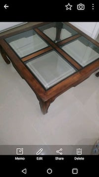 brown wooden framed glass top coffee table Cutler Bay, 33157