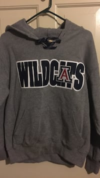 gray and black Wildcats pull-over hoodie
