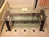 Brown wooden framed glass top table New York, 10031