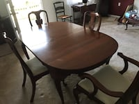 Oval brown wooden table with four chairs dining set Virginia Beach, 23462