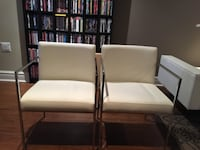 two brown wooden framed white padded armchairs Bolton