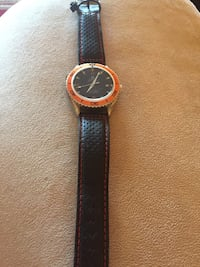 round gold analog watch with black leather strap Toronto, M3N 2V2