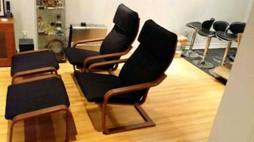 Two Poang chairs and matching foot rests