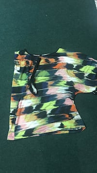 green, black, pink, and red tie-dye t-shirt