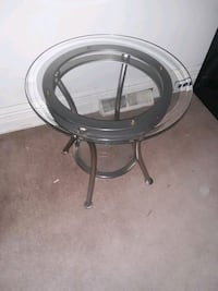 Glass end table with bottom shelf