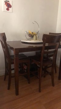 oval brown wooden table with six chairs dining set Pasadena, 91104
