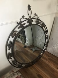 """57"""" X42 diameter  beveled mirror steel frame, must be anchored to wall, very heavy. Cambridge, N1R 4R6"""