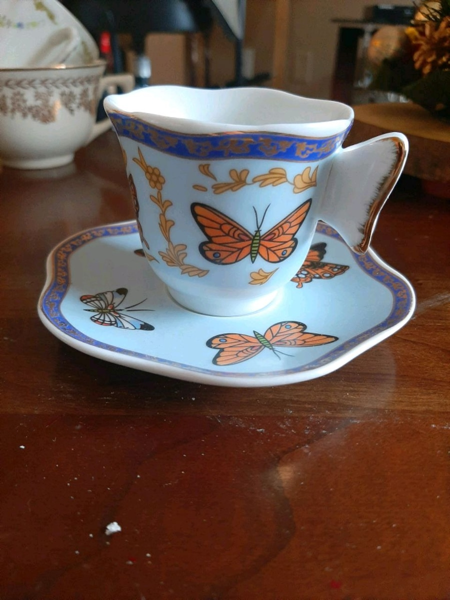 Photo Collectors rare butterfly handle blue china tea cup