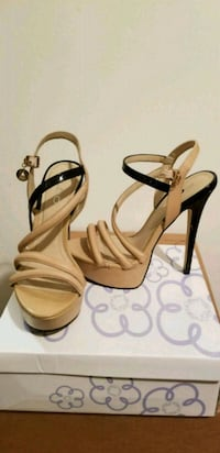 pair of brown leather open toe ankle strap heels Edmonton, T5M 1C1