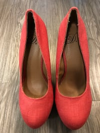 pair of red suede heeled shoes 2387 mi