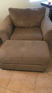 Oversized brown chair with ottoman  1927 mi