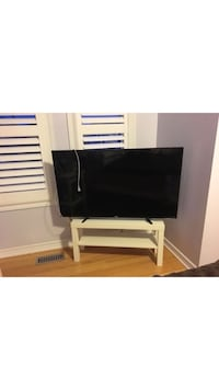 black flat screen TV with brown wooden TV stand Vaughan, L4L 7X5