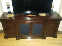 brown wooden TV stand with flat screen television Montreal