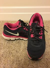 pair of black-and-pink Nike running shoes Aurora, L4G 2S1