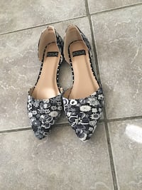 pair of black-and-white floral flats 954 mi