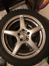4 like-new winter tires with wheels