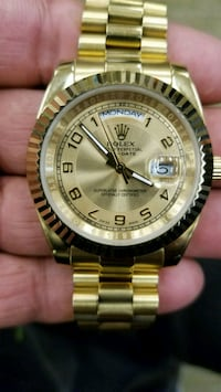 round gold Rolex analog watch with link bracelet Clearwater, 33764
