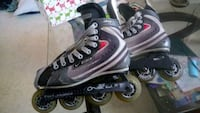pair of black-and-white inline skates Laval, H7H 1Y2