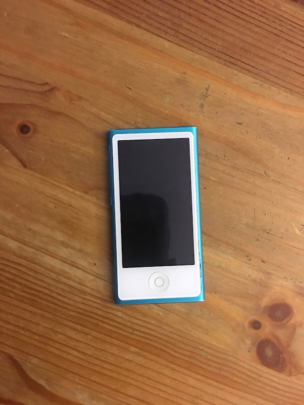 silver iPhone 6 with blue case