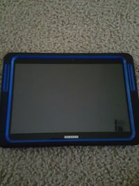black samsung tablet computer with blue case