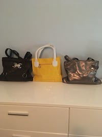 two black and brown leather handbags Glendale, 85308
