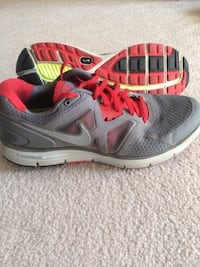 pair of gray-and-pink Nike running shoes Calgary