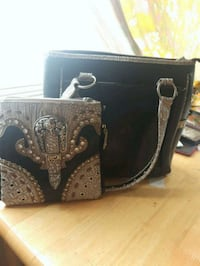 black and brown leather purse  Winnipeg, R2W 1Y5