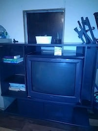 Black heavy Entertainment Center with side book case (tv included)