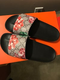 pair of black-and-red slide sandals South Frontenac, K0H