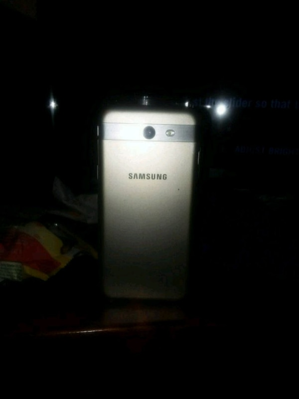 Grey Samsung Galaxy j3 emerge android smartphone