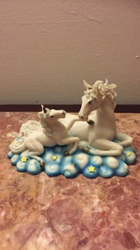 White and blue ceramic horse figurine