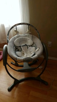 baby's gray and white cradle and swing