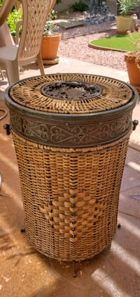 Rattan and metal storage/laundry  basket. Henderson, 89052