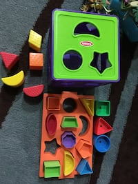 green, pink, and blue plastic toy
