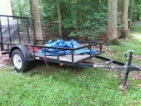 black and brown utility trailer 41 km