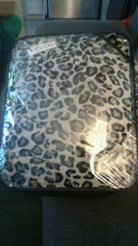 White and black leopard print textile