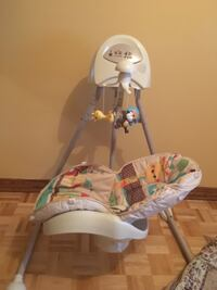 baby's white and green cradle and swing Montréal, H1S 3E3