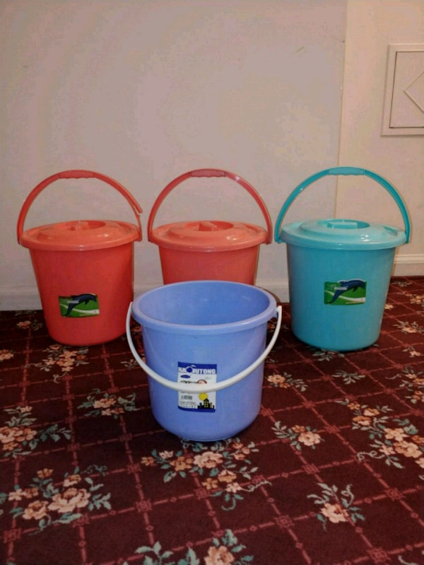 4 buckets 3 with lids almost new
